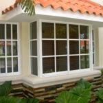 Какие окна выбрать для загородного дома — металлопластиковые или деревянные